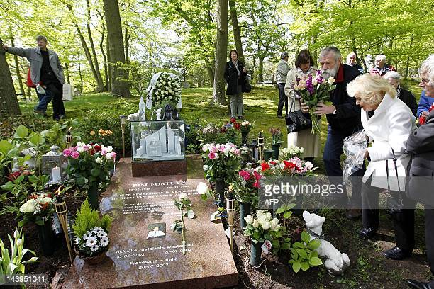 Visitors attend the memorial mass for Dutch rightwing politician Pim Fortuyn at the graveyard in Driehuis on May 6 2012 Fortuyn was murdered 10 years...