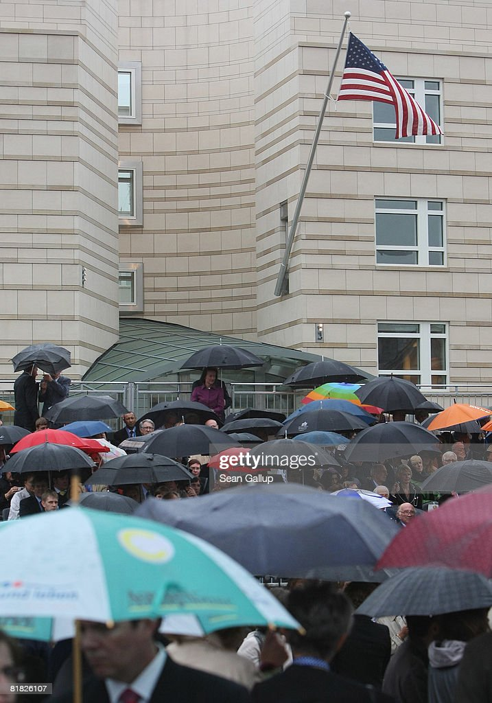 Visitors attend the official opening ceermony of the new U.S. embassy on July 4, 2008 in Berlin, Germany. Architectural critics claim the embassy, designed by American architect Moore Ruble Yudell, offers little in architectural innovation or design.