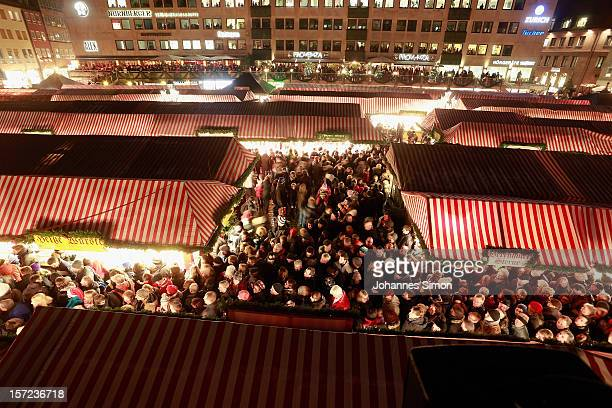 Visitors attend the opening ceremony of the traditional Christmas market 'Nuernberger Christkindlesmarkt' on November 30 2012 in Nuremberg Germany...