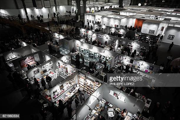 Visitors attend the opening of the 20th edition of Paris Photo, the international fine art photography fair at the Grand Palais in Paris on November...