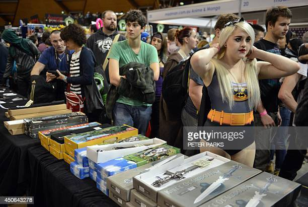 Visitors attend the Supanova Pop Culture Expo in Sydney on June 15 2014 The threeday event in which thousands of fans dress up in 'Cosplay' showcases...