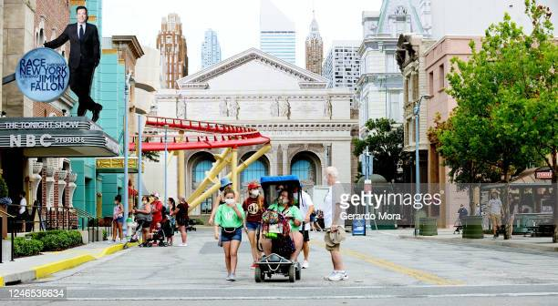 Visitors attend the Universal Studios theme park first day of reopening from the coronavirus pandemic at Universal Orlando Resort on June 05 2020 in...