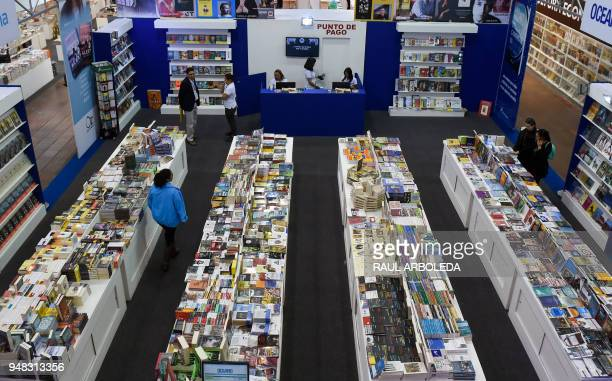 Visitors attend the XXXI International Book Fair of Bogota on April 18, 2018 in Bogota. Argentina is this year's guest of honour at the fair. / AFP...