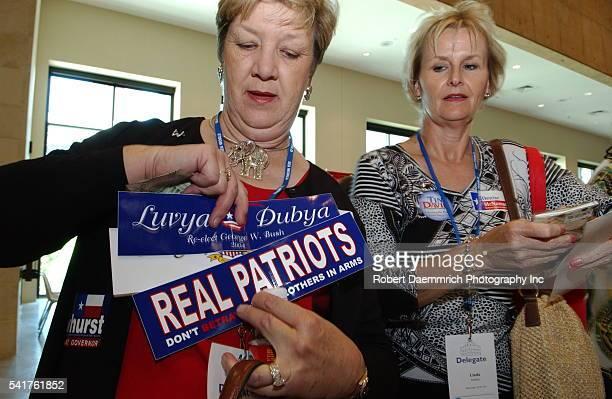 "Visitors attending the bi-annual Texas Republican Convention purchase patriotic paraphernalia at the ""Bushstore04."""