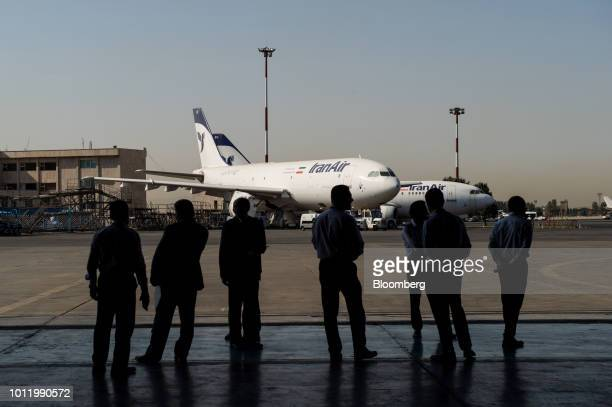 Visitors await the arrival of the new twin engine ATR 72600 turboprop aircraft due to fly into Mehrabad International airport in Tehran Iran on...