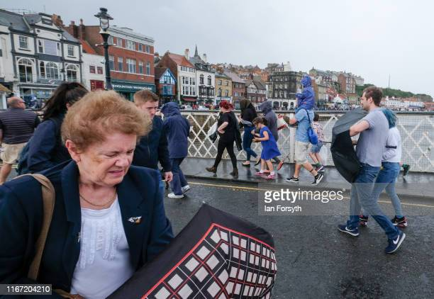Visitors battle strong winds during a thunderstorm at the annual Whitby Regatta on August 10 2019 in Whitby England At over 170 years old the Whitby...