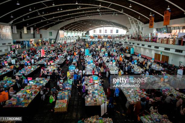 Visitors browse and read books during the opening of the 2019 Big Bad Wolf Book exhibition in Surabaya in East Java on October 4 2019 The exhibition...