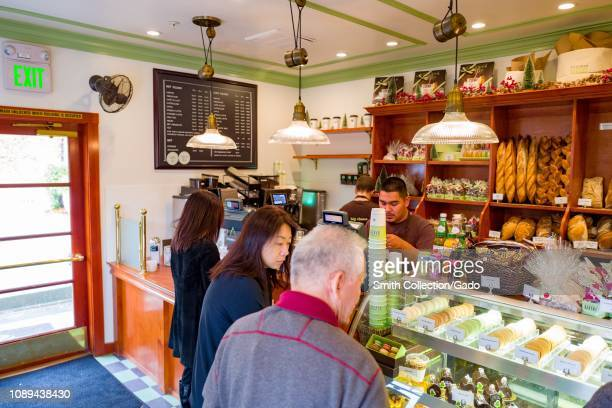Visitors browse baked goods at the popular Bouchon Bakery in Yountville California connected with Bouchon Bistro the flagship bistro restaurant of...