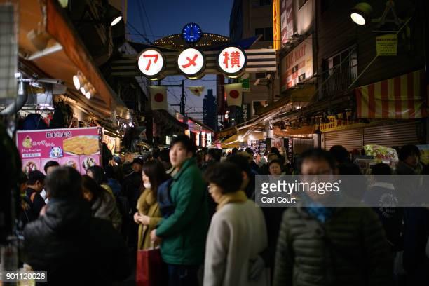 Visitors browse goods as others pass through Ameya Yokocho market on January 4 2018 in Tokyo Japan Ameya Yokocho claimed to be Tokyo's last remaining...
