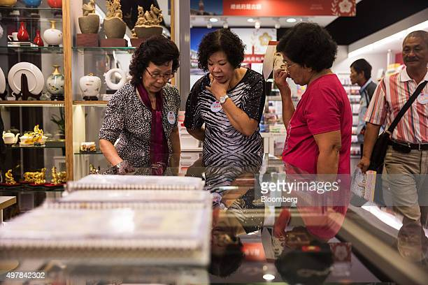 Visitors browse merchandise at the souvenir shop of the presidential palace in Taipei Taiwan on Wednesday Nov 18 2015 President Ma Yingjeou is...