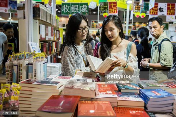 Visitors browse through books on display at the International Book Fair in Hong Kong on July 20, 2017. This year's book fair, held at the Hong Kong...