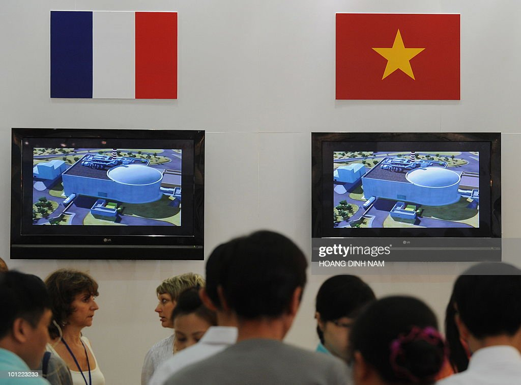 Visitors browse through documents at a French booth during an exhibition on nuclear power being held in Hanoi on May 28, 2010. Vietnam plans to build its first nuclear power stations which should be operational from 2020. AFP PHOTO/HOANG DINH Nam