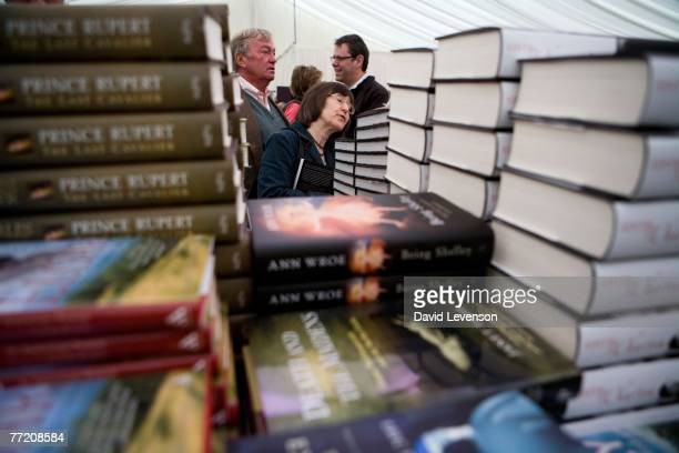 CHELTENHAM ENGLAND OCTOBER 6 Visitors browsing at a bookshop at the Cheltenham Literature Festival held at Cheltenham Town Hall on October 6 2007 in...