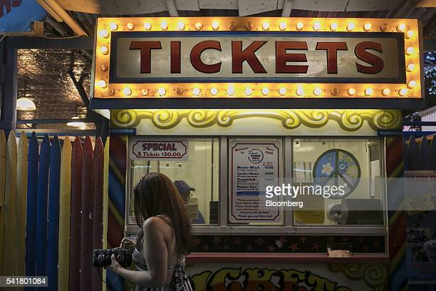 Visitors buy tickets for rides at Coney Island in the Brooklyn borough of New York US on Saturday June 18 2016 The summer solstice arrives on June 20...