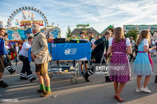 Thousands of visitors rush onto the festival area after the official entrance opening to get the best places on the first day of the 2018 Oktoberfest...