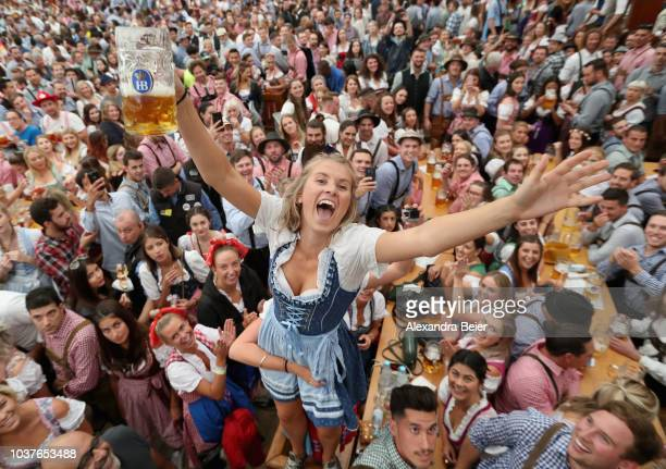 Visitors celebrate in a beer tent on the opening day of the 2018 Oktoberfest beer festival on September 22 2018 in Munich Germany The Oktoberfest...