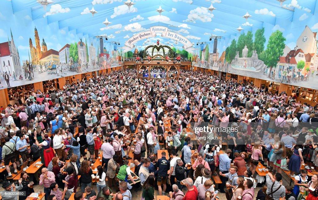 Visitors celebrate in the beer tent u0027Hacker-Pschorr - Himmel der Bayernu0027 ( & Oktoberfest 2017 Photos and Images | Getty Images