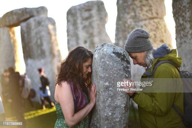 Visitors celebrate summer solstice and the dawn of the longest day of the year at Stonehenge on June 21, 2019 in Amesbury, England. Visitors and...