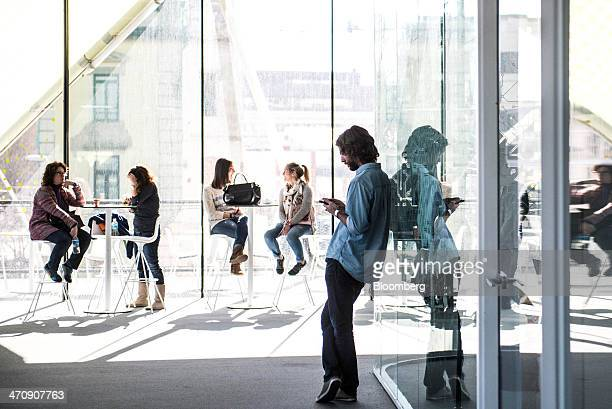 Visitors chat and use mobile phones in a rest room at the Barcelona Growth Center in Barcelona Spain on Thursday Feb 20 2014 A smart city initiative...