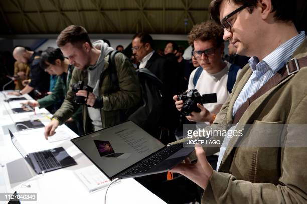 Visitors check Huawei's new laptop MateBook X Pro at the Mobile World Congress on the eve of the world's biggest mobile fair on February 24 2019 in...