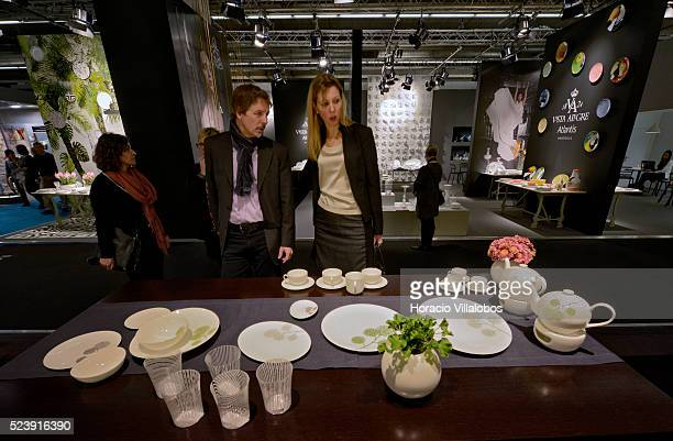 Visitors check on tableware at Dibbern stand in Ambiente 2014 in Frankfurt Germany 10 February 2014 Ambiente is the leading international trade fair...