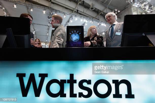 Visitors check out a slimmed down version of the IBM Watson supercomputer recently featured on the Jeopardy television game show at the IBM stand at...