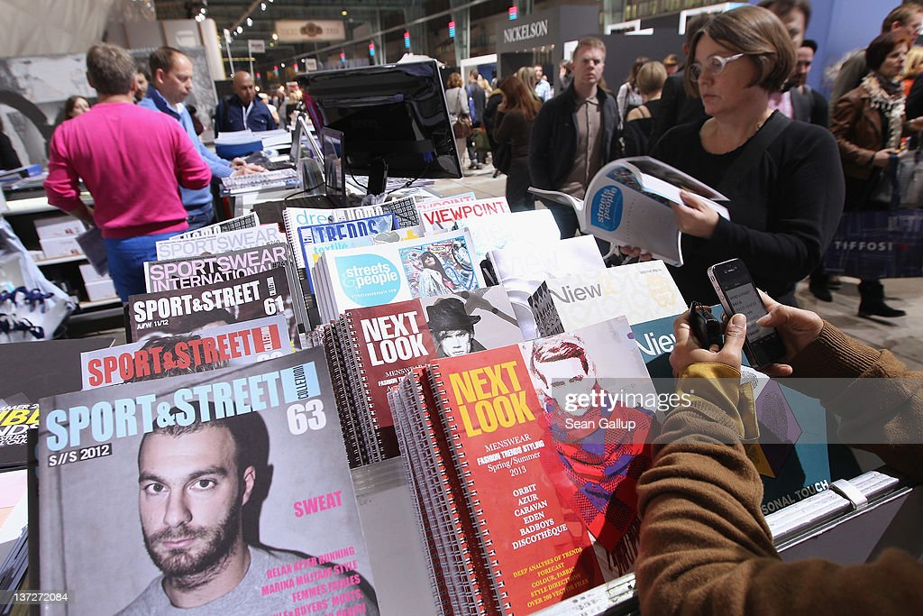 Visitors check out fashion industry publications at the 2012 Winter Bread And Butter fashion trade fair at former Tempelhof Airport on January 18, 2012 in Berlin, Germany. Bread And Butter is a semi-annual event and is among Europe's major fashion trade fairs.