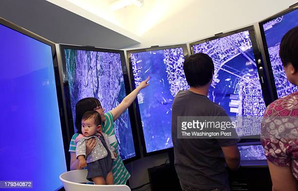 Visitors check out Google Earth at Google's headquarters in Manhattan NY on August 22 2013