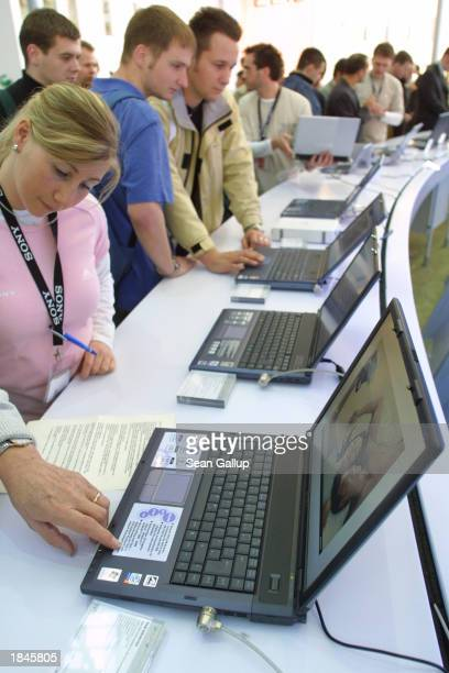 Visitors check out the latest Sony Vaio laptop computers at the CeBIT technology trade fair March 13, 2003 in Hanover, Germany. CeBIT, the world's...