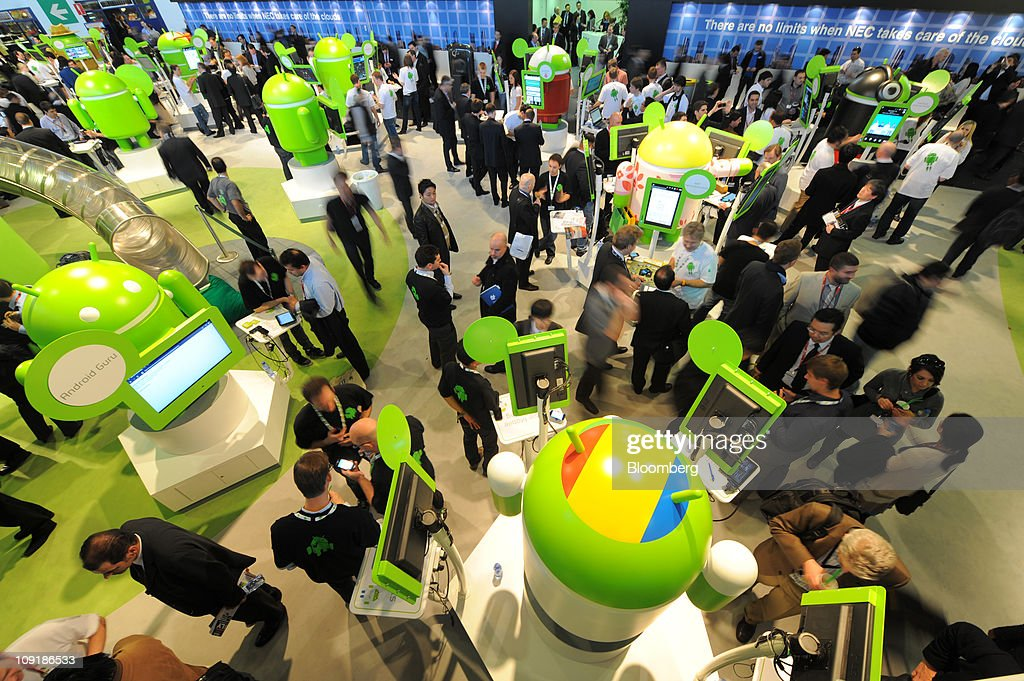 Visitors check out the trade stand for Android operating software at the Mobile World Congress in Barcelona, Spain, on Wednesday, Feb. 16, 2011. Google Inc. will start applications based on its Android operating software for Google TV this year Donagh O'Mally, Youtube head of partnerships for the U.K., Ireland and the Benelux countries, said today. Photographer: Denis Doyle/Bloomberg via Getty Images