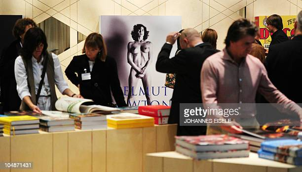 Visitors check through books at the stand of publisher Taschen during the 62nd International Book Fair in Frankfurt am Main on October 6 where...