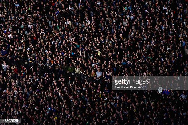 Visitors cheer during the first day of the Lollapalooza Berlin music festival at Tempelhof Airport on September 12 2015 in Berlin Germany