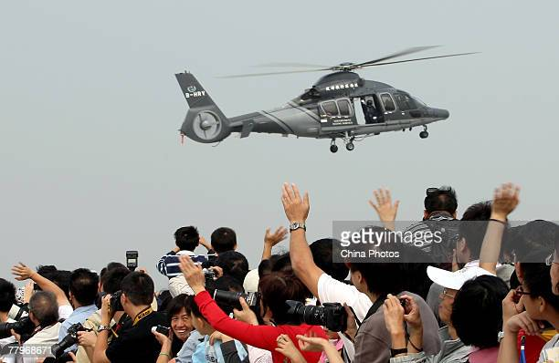Visitors cheer for a Eurocopter EC155 B1 Helicopter in a demonstration during the Government Flying Service Open Day on November 18 2007 in Hong Kong...
