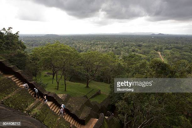 Visitors climb a flight of steps leading to the top of the 'Lion Rock' at the Ancient City of Sigiriya near Dambulla Central province Sri Lanka on...
