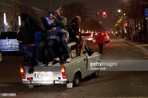 Visitors climb a Trabant the EastGermany built car at the Brandenburg Gate after celebrations on the 25th anniversary of the fall of the Berlin Wall...