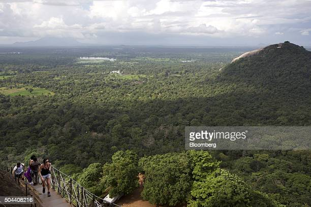Visitors climb and descend a flight of steps leading to the top of the 'Lion Rock' at the Ancient City of Sigiriya near Dambulla Central province Sri...