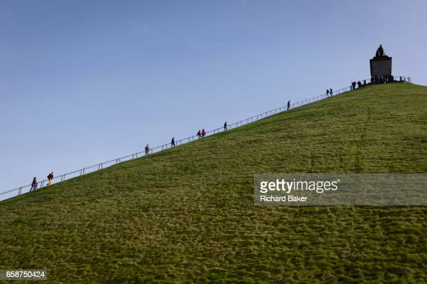 Visitors climb and descend the 225 steps 43 metre high Waterloo Lion's battlefield Mound on 25th March 2017 at Waterloo Belgium The Lion's Mound...
