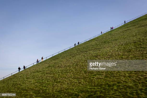 Visitors climb and descend the steep gradient of 225 steps 43 metre high Waterloo Lion's battlefield Mound on 25th March 2017 at Waterloo Belgium The...