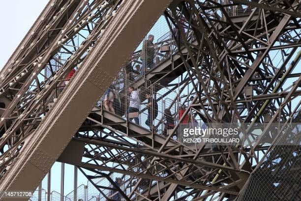 Visitors climb stairs of the Eiffel Tower on April 11 2012 in Paris after an elevator broke down The east pillar lift is the only one in operation...