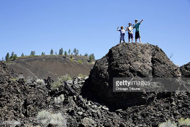 Visitors climb the natural formations at the Newberry National Volcanic Monument in Deschutes National Forest near Sunriver, Oregon.