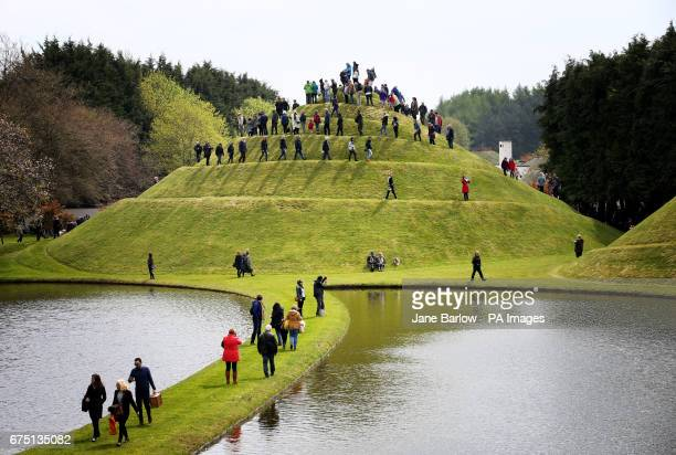 Visitors climb the Snail Mound in the Garden of Cosmic Speculation in the grounds of Portrack House near Dumfries.