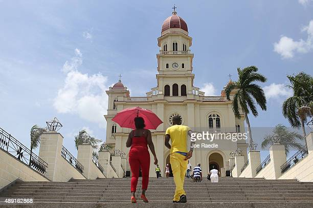 Visitors climb the stairs to the El Cobre church where the Pope is scheduled to attend a mass on September 19 2015 in Santiago de Cuba Cuba Pope...