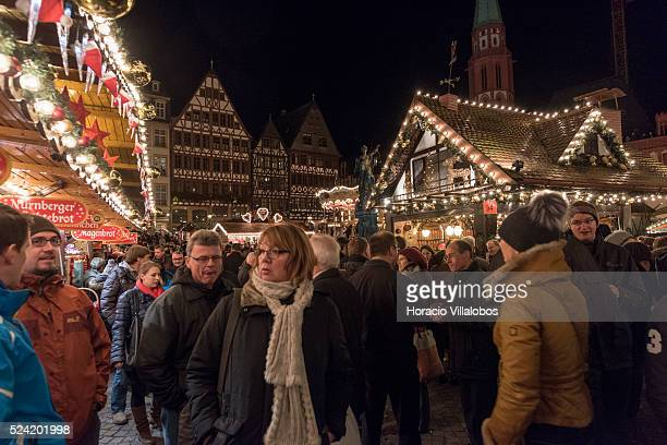 Visitors congregate at the Christmas market in Roemerberg Frankfurt Germany 08 December 2014 Hundreds of visitors gather every night to enjoy typical...