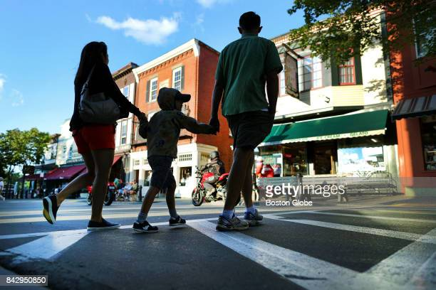 Visitors cross Main Street which is filled with many colorful shops in Bar Harbor ME on Aug 24 2017 Cruise ships visiting Bar Harbor are a boon to...