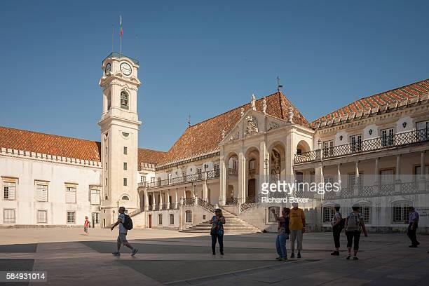 Visitors cross Patio das Escolas to admire the bell tower and Via Latina of Coimbra University one of the oldest and illustrious universities and...