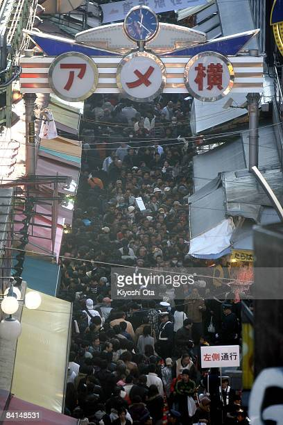 Visitors crowd a street in the Ameya Yokocho street market on December 31 2008 in Tokyo Japan People shop around in preparation to celebrate the New...