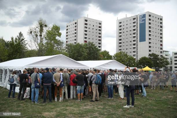 Visitors crowd a tent to hear a presentation at a gathering hosted by the Identitarian Movement on August 25 2018 in Dresden Germany The Identitarian...