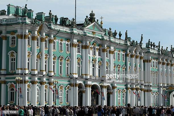 Visitors crowd in front of the State Hermitage museum on June 19 2010 in St Petersburg Russia The State Hermitage founded in 1764 by Catherine the...