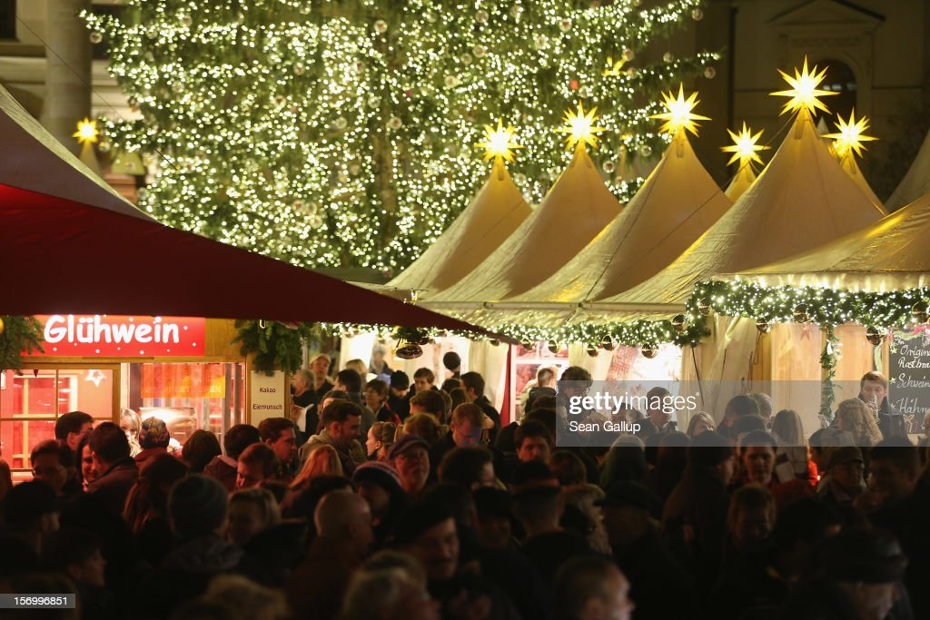 Visitors crowd the annual Christmas market at Gendarmenmarkt on its opening day on November 26, 2012 in Berlin, Germany. Christmas markets, with their stalls selling mulled wine (Gluehwein), Christmas tree decorations and other delights, are an integral part of German Christmas tradition, and many of them opened across Germany today.