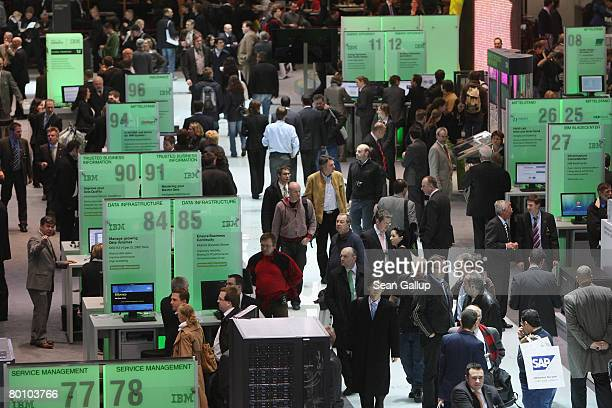 Visitors crowd the IBM stand at the CeBIT technology fair on the first day the fair opened to the public on March 4, 2008 in Hanover, Germany. CeBIT,...